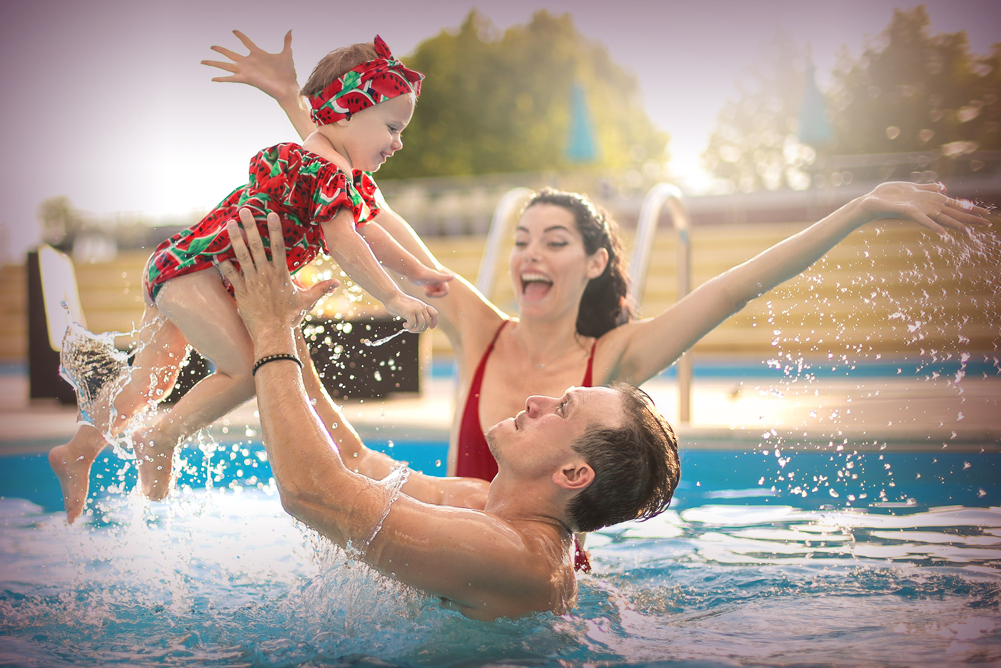 A happy family enjoying time in the pool. Some helpful tips and advice for pool safety for kids and families.
