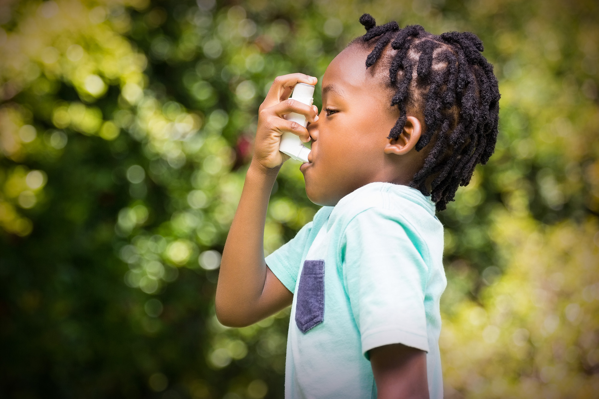A photo of a child taking medication at school